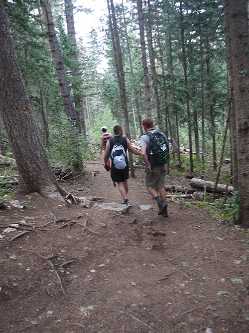 Hiking with friends on the La Luz trail after reaching the Sandia Peak.