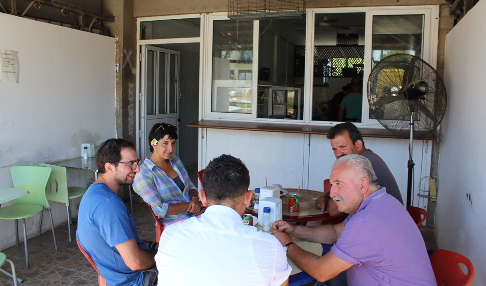 Antoniou and her team chat with locals at a restaurant