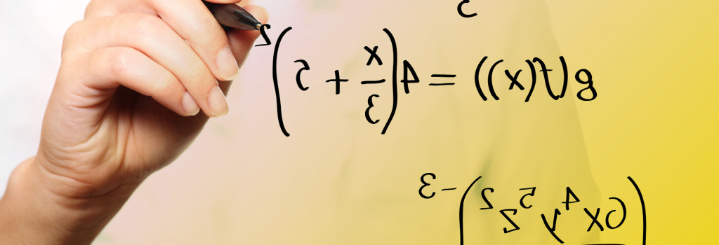 A woman writes functions and an expression on a clear board.