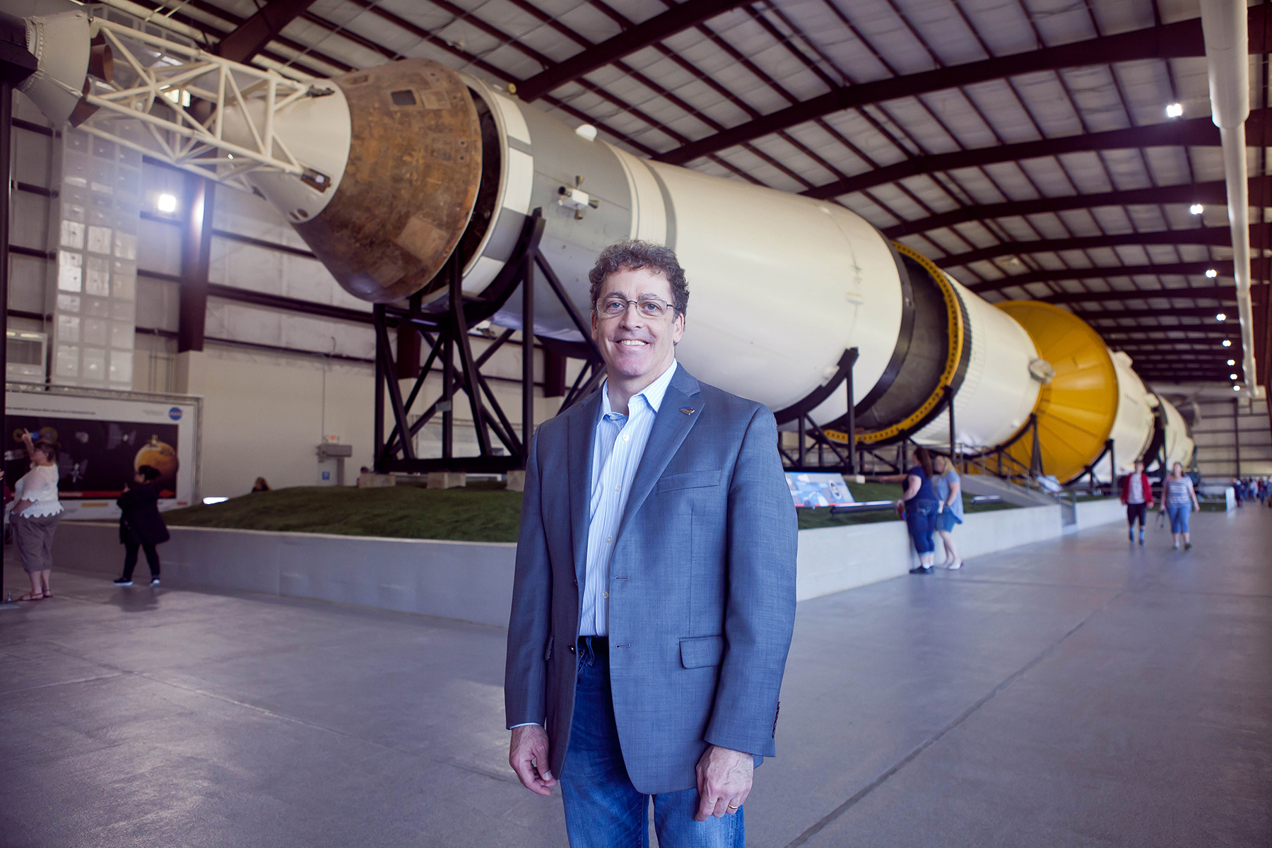 Brian Rishikof standing in front of a rocket