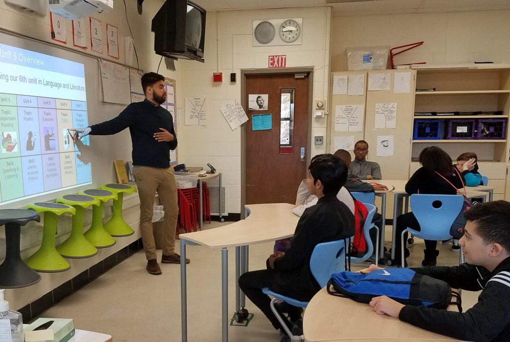 Muneer Khalid teaches in his classroom.