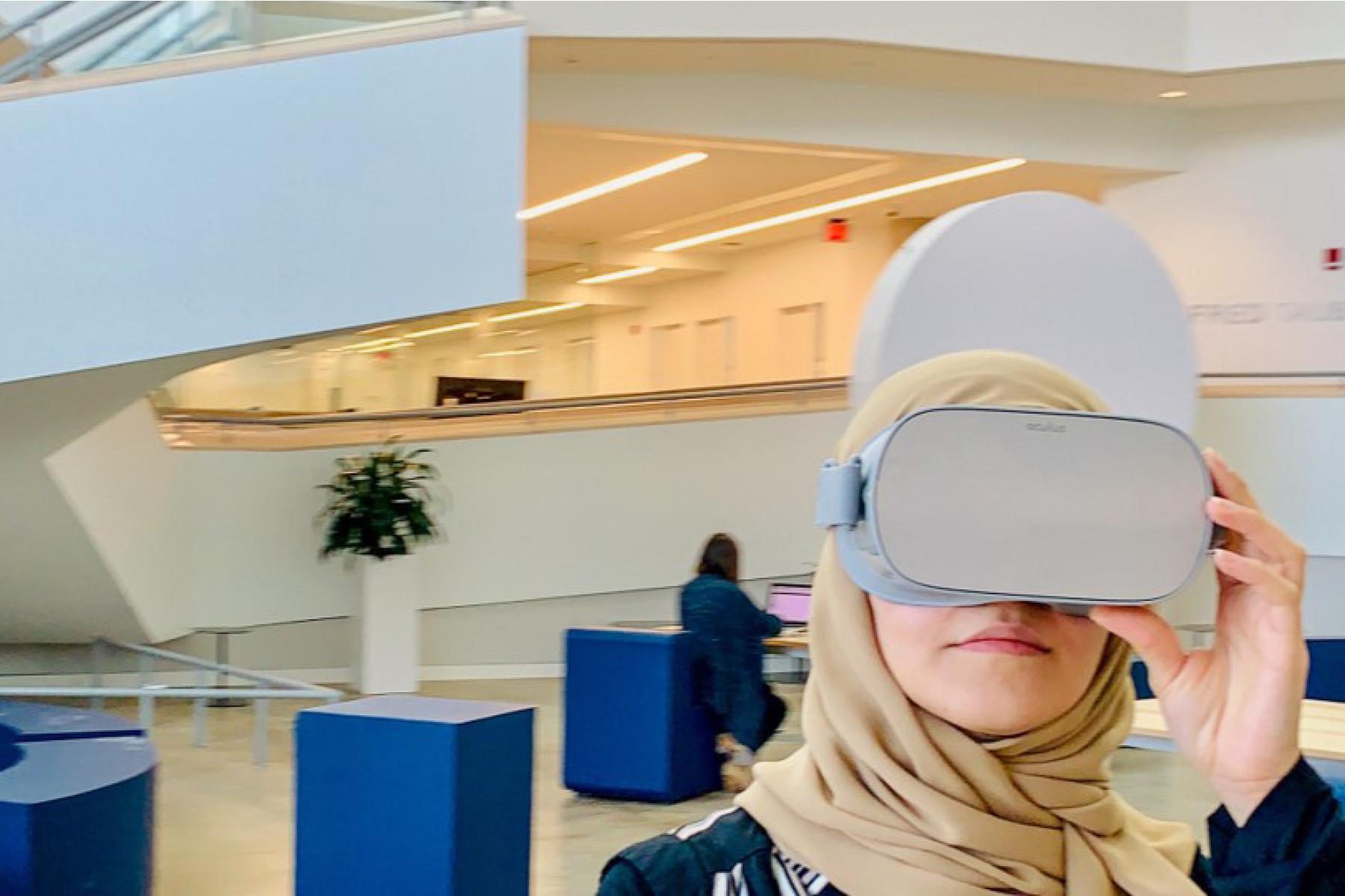 Alaa Algargoosh wears a virtual reality headset inside a church.