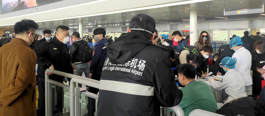 People wearing face masks in an airport.
