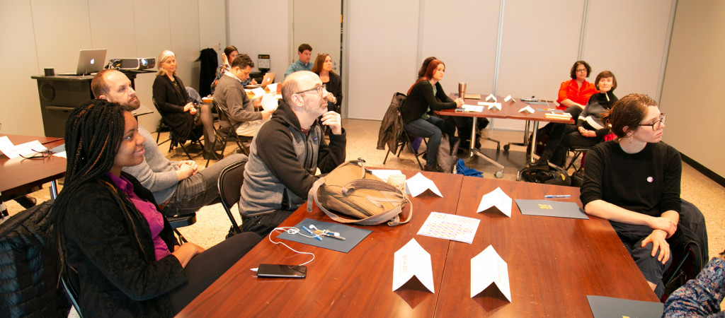 Graduate students and faculty attend a Rackham Program in Public Scholarship workshop.