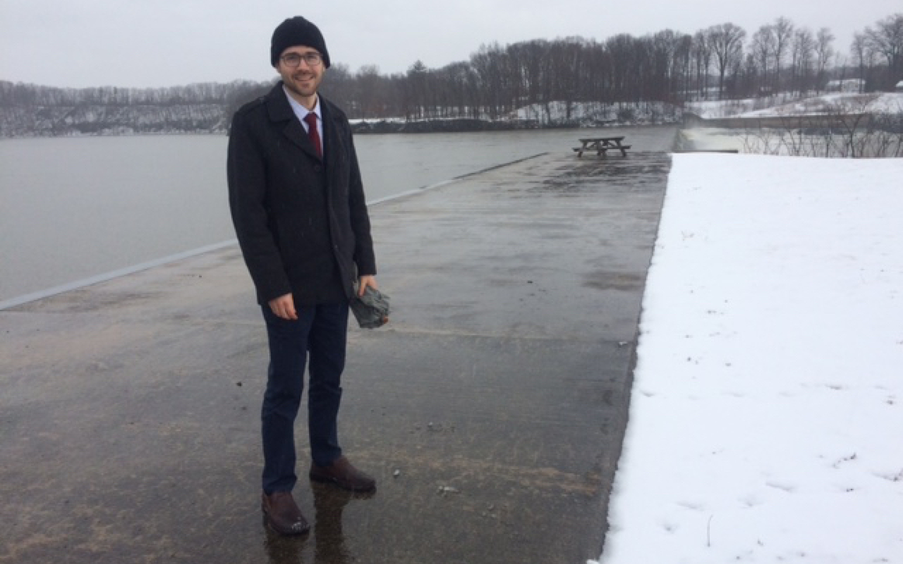 Jacob Kvasnicka stands on the shore of the Hudson River in winter.