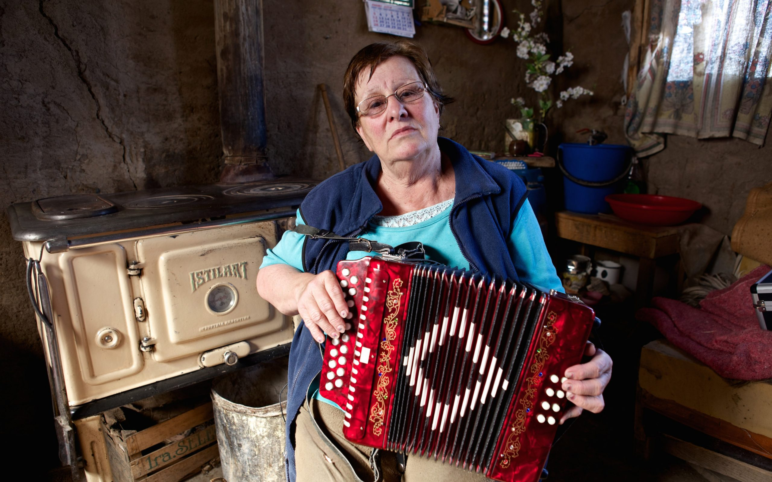 A woman in Patagonia plays her accordion.