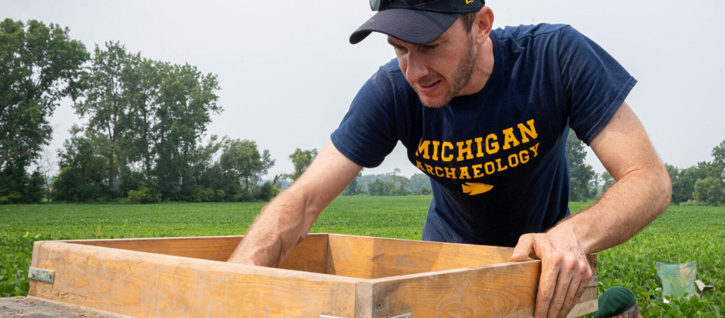 Brendan Nash looks for artifacts at the Belson Site.
